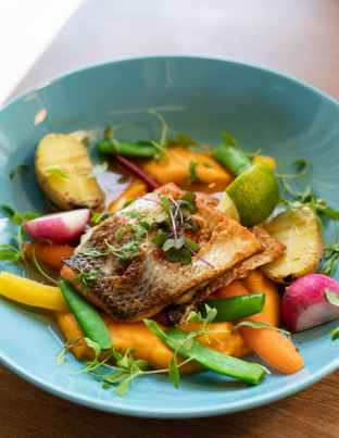 fried fish and vegetables on plate